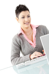 Happy businesswoman using computer