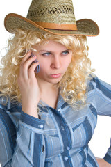 blonde girl in straw hat with cellular phone