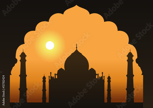 A view of the Taj Mahal framed through a doorway.