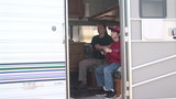Two people playing video games inside an R.V. Trailer poster