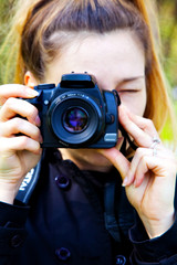 Female photographer with photo camera in hands