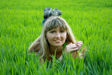 girl siting on the grass in the field