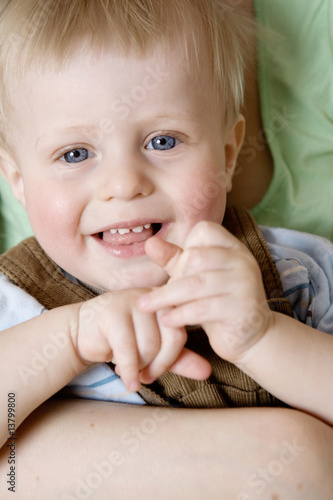 young smiling blond little boy