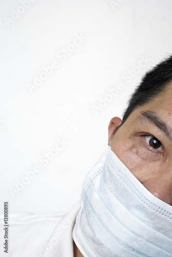 Asian man in medical mask hiding part of his face