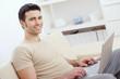 Happy man using computer