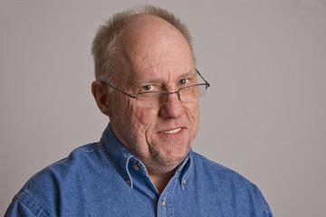 Older Man in Glasses Smiling Head Tilted