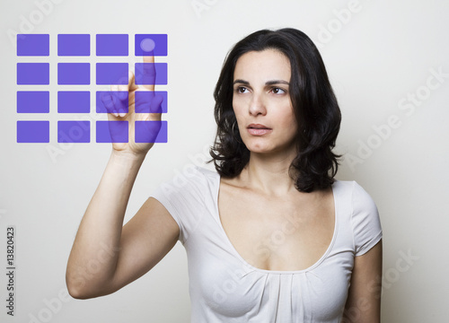 Young woman pointing on a virtual screen