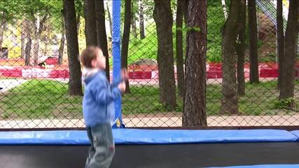 child on trampoline