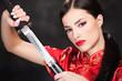 Pretty woman holding katana weapon