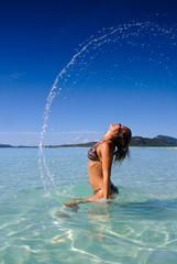 Beautiful young teen flinging hair in water
