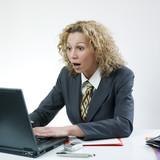 Shocked businesswoman poster