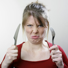 Unhappy face with cutlery