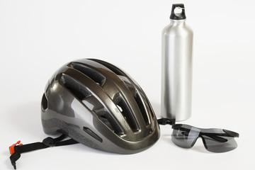 Bike helmet sunglasses and metal water flask