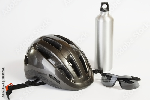 Bike helmet sunglasses and metal water flask