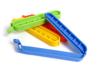 Clips for food Bags in various colors on white background