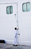 Man Scrubbing Ship