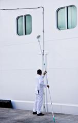 Man Scrubbing Ship