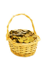 Basket full of coins isolated on white
