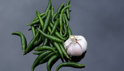 Green chilli peppers and Garlic bulb