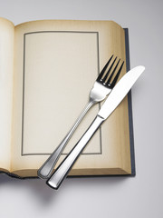 cutlery set on  book