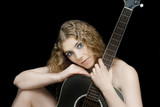Beautiful woman holding a guitar infront of herself. poster