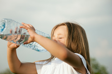 Kid drinking bottled water