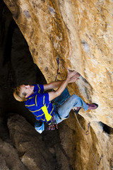 Climber going for the next handhold.