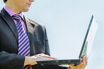 Businessman working with a laptop outdoor
