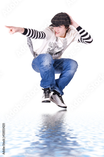 Teenage boy jumping and dancing Locking or Hip-hop dance