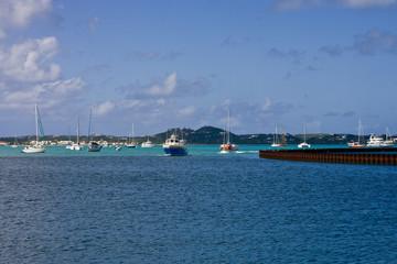 Blue Ferry Past Sailboats