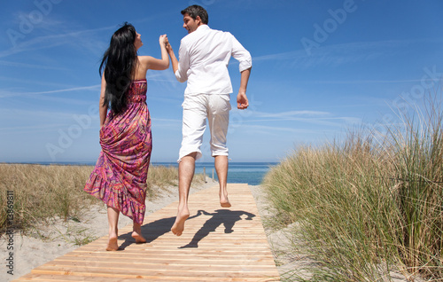 couple enjoying themselves on the beach