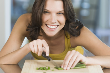 Woman chopping chives