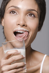 Close-up of a woman drinking milk from a glass