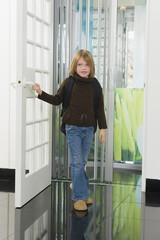 Girl entering a house