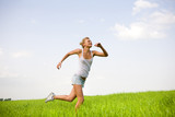 Happy young women runing in field poster