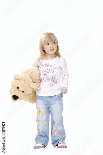 The little girl with a toy bear