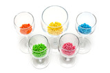 Transparent glasses with colour sweetmeat poster
