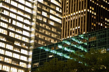 Urban buildings reflected in the glass windows of skyscrapers.