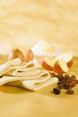 Phyllo pastry dough, eggs, flour, butter, apples, raisins