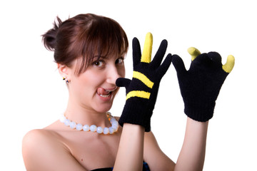 The beautiful woman in gloves - shows gesture and put out one's