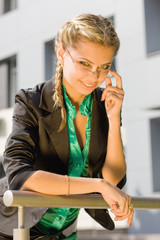A beautiful young business woman wearing glasses