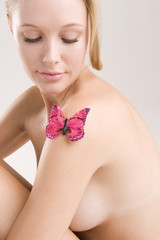 Butterfly on a woman's shoulder