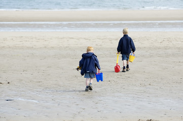boys playing at beach