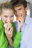 Close-up of a couple eating fruits