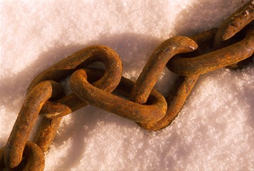 Rusted link chain on snow