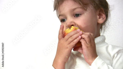 little girl with peach