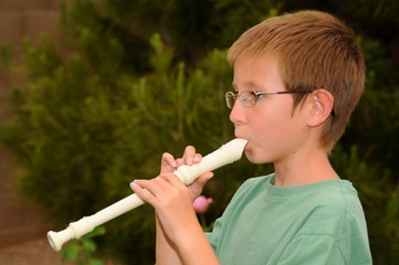Boy playing a recorder