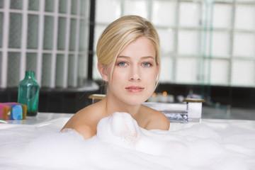 Woman taking a bubble bath