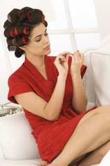 Woman filing nails with a nail file