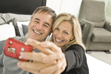Couple taking picture of themselves with a digital camera